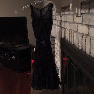 Navy blue mid calf dress. Sheer and satin sash.